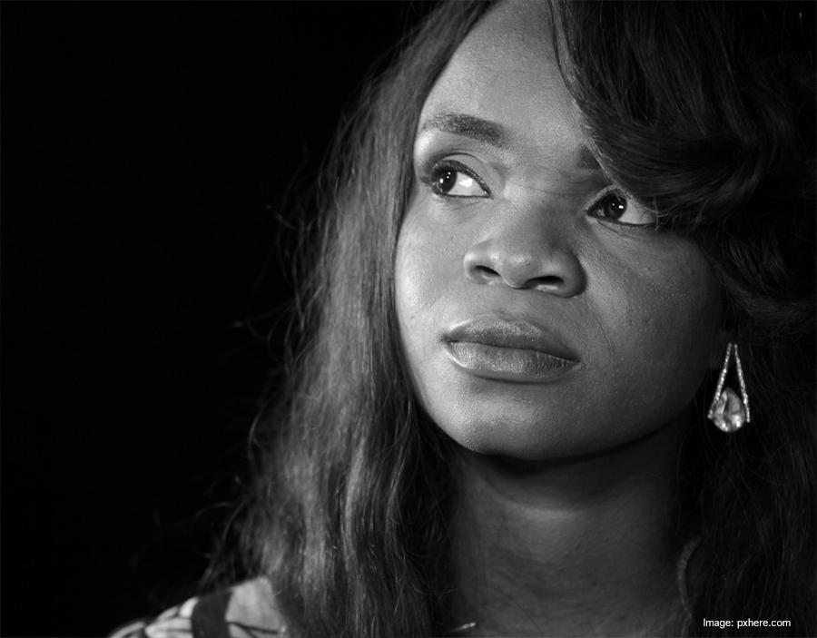 "Black Woman THinking ""As A Man Thinketh"" michaelsoaries.com"